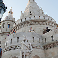 Tourists watch the city from a tower of the Castle of Buda on summer sightseeing in Budapest, Hungary on August 25, 2011. ATTILA VOLGYI