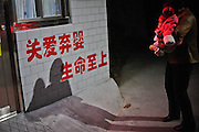 Anguish of the mothers forced to hand over their children: Heartbreaking moments parents say goodbye to their sons and daughters at China's 'baby hatches'<br /> <br /> These heartbreaking photos reveal the anguish of parents as they abandon their children in China's so-called 'baby hatches.'<br /> The images taken at a centre in Guangzhou - one of 25 such hatch facilities in mainland China, spanning 10 provinces and major cities - show the last moments before parents give up their infants  often due to poverty or an inability to cope with disease or disability.<br /> Abandoning children is illegal in China, but the 'hatches' were introduced so parents could abandon infants safely rather than leaving them in the streets.<br /> <br /> But critics argue it encourages drastic action and believe some parents may feel it is more socially acceptable to abandon their children. <br /> <br /> The hatch in opened in January, but staff were forced to shut the door just two months later after becoming overwhelmed with 262 abandoned youngsters - all of which were ill or disabled. <br /> 'My baby cannot take care of itself when it grows up. I just want my baby to survive,' said a mother reported the South China Morning Post.<br /> <br /> In one of the photos an uncle is seen leaving his niece who he says is suffering from leukemia and her parents can not afford her medical bills. <br /> Another distressing image shows a man crying after being told his baby is too old to be accepted.<br /> A couple, whose child has Pierre Robin syndrome - congenital condition of facial abnormalities in humans - are also photographed walking to the centre to give up their child.  <br /> A parent typically opens a door and places their infant in a small room, rings a bell and leaves before welfare services collect the child. <br /> Last month the welfare home's director Xu Jiu announced the suspension and told Xinhua news agency: 'I hope everyone understands the difficulties the welfare centre face.'