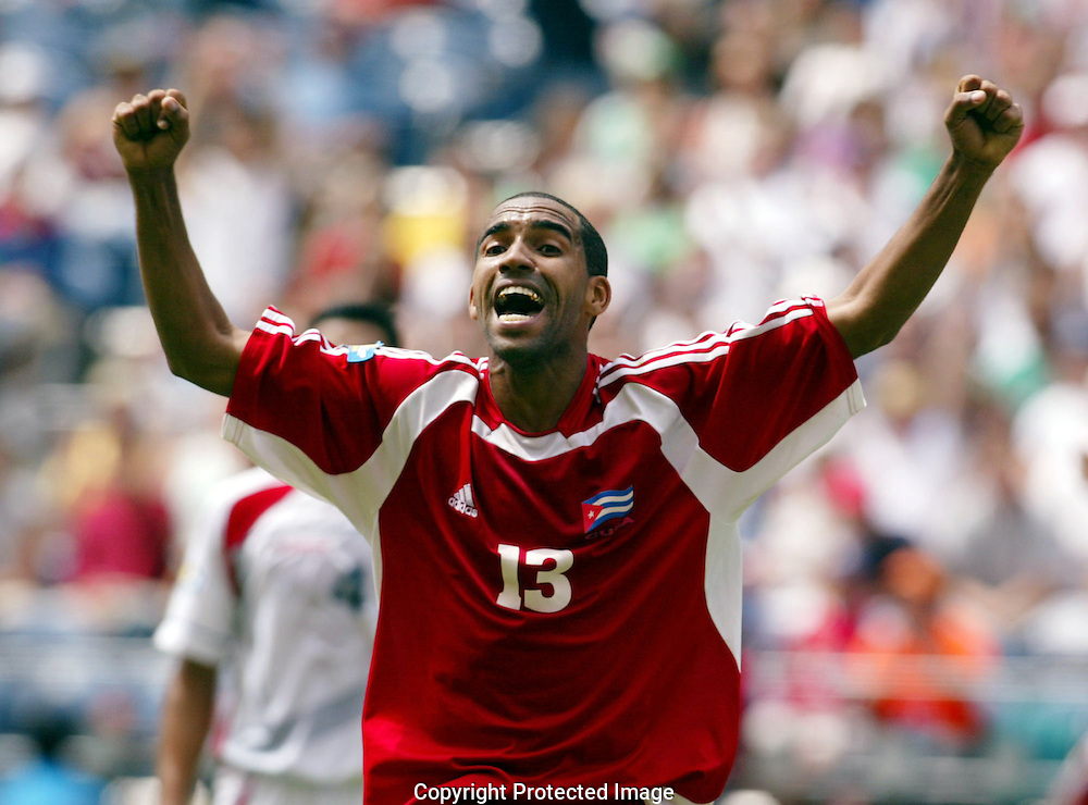 Cuba's Maykel Galindo celebrates a score against Costa Rica in the second game of pool play in the  CONCACAF Gold Cup tournament in Seattle. Galindo defected after the games. (AP Photo/John Froschauer)