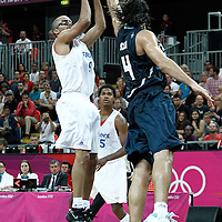 31 July 2012: Tony Parker of France takes a jumpshot over Luis Scola during 71-64 Team France victory over Team Argentina, during the men's basketball preliminary, at the Basketball Arena, in London, Great Britain.