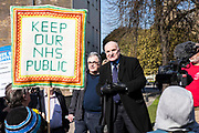 A member of the House of Lords speaks to a group of members of the public at a rally against the against the government section 75 privatization regulations which they believe will force the National Health Service into privatization.