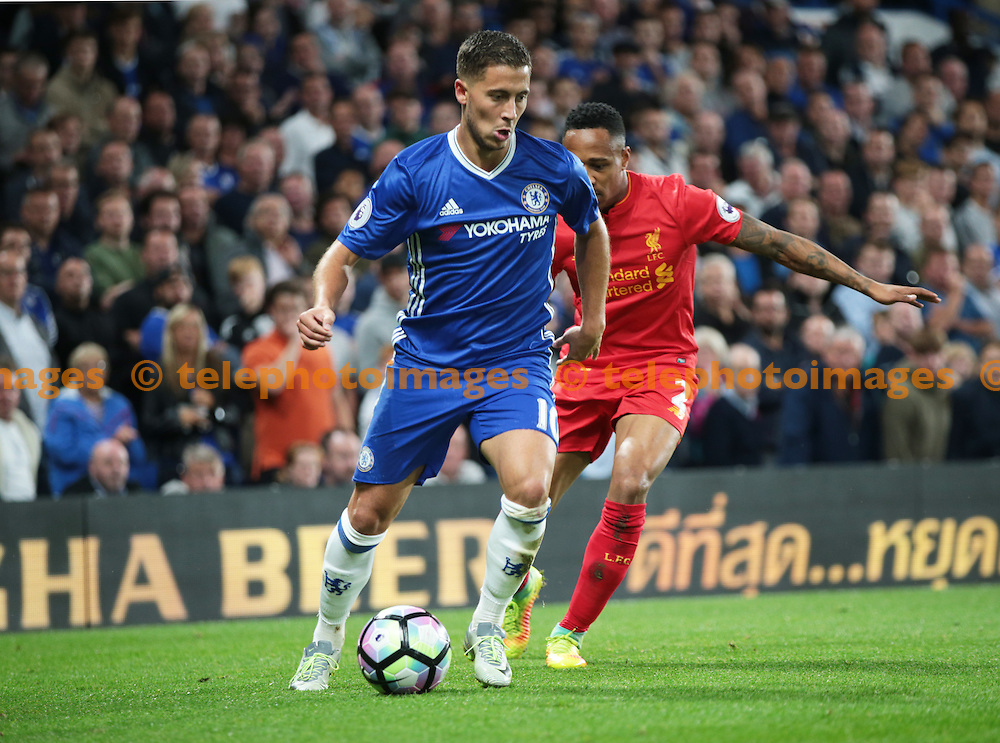 Chelsea's Eden Hazard holds of Liverpool's Nathaniel Clyne<br /> during the Premier League match between Chelsea and Liverpool at Stamford Bridge in London. September 16, 2016.<br /> James Galvin / Telephoto Images<br /> +44 7967 642437