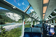 """Ruinaulta (or Rheinschlucht, the Rhine Gorge of Switzerland, or Swiss Grand Canyon) was created by the Anterior Rhine between Ilanz/Glion and Reichenau, in the debris of the Flims Rockslide, in eastern Switzerland, the Alps, Europe. Panorama cars of the Glacier Express train, operated jointly by the Matterhorn Gotthard Bahn (MGB) and Rhaetian Railway (RhB), provide views through the Rhine Gorge. Its local name Ruinaulta means """"high heap of rubble"""", referring to the bizarre whitish rock formations, debris from a prehistoric rockslide that 10,000 years ago blocked the Rhine (near Flims) after the retreat of the Ice Age valley glacier. Since then, river erosion has cut an impressive gorge. Protected by cliffs several hundred meters high, the forested area is a haven for wildlife. This stretch of the river, now popular for rafting, was largely inaccessible until the Chur-Ilanz section of Rhaetian Railway, or Rhätische Bahn (RhB), opened in 1903. In 2008, the """"Rhaetian Railway in the Albula/Bernina Landscapes"""" (the part from Thusis to Tirano, including St Moritz) was honored as a UNESCO World Heritage Site. Rheinschlucht is just upstream of the Anterior Rhine's confluence with the Posterior Rhine at Reichenau in the Grisons/Graubünden/Grigioni/Grischun canton of Switzerland."""