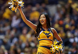 Jan 12, 2019; Morgantown, WV, USA; A West Virginia Mountaineers cheerleader performs during the first half against the Oklahoma State Cowboys at WVU Coliseum. Mandatory Credit: Ben Queen-USA TODAY Sports