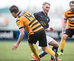 Alloa Athletic's Connor McManus tackles Falkirk's Craig Sibbald. <br /> Falkirk 2 v 0 Alloa Athletic, Scottish Championship game played 5/3/2016 at The Falkirk Stadium.