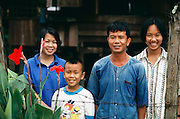 Thailand: The Khuenkaew family of Ban Muang Wa village, outside the northern town of Chiang Mai, in Thailand. The Khuenkaews are a farming family that grows rice for personal use, and to sell for income. The Khuenkaew's live in a wooden 728-square-foot house on stilts, surrounded by rice fields. Material World Project.