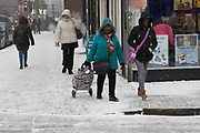 People struggle to go about their daily lives in freezing weather, dubbed The Beast from the East due to the sub zero cold temperature winds coming in from Siberia, descends on Kings Heath High Street on 1st March 2018 in Birmingham, United Kingdom.