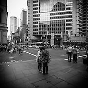 Asian girls reading a map on a street corner in Sydney, Australia