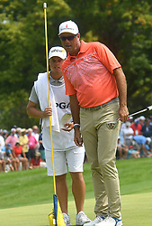 August 12, 2018 - St. Louis, Missouri, U.S. - ST. LOUIS, MO - AUGUST 12: Stewart Cinc checks the lay of his ball on the #1 green during the final round of the PGA Championship on August 12, 2018, at Bellerive Country Club, St. Louis, MO.  (Photo by Keith Gillett/Icon Sportswire) (Credit Image: © Keith Gillett/Icon SMI via ZUMA Press)
