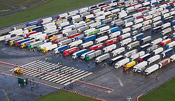 © Licensed to London News Pictures. 22/12/2020. Manston, UK. Drivers are seen on the runway as hundreds of trucks fill  the former RAF airfield at Manston in Kent as the Port of Dover remains closed.  France is among a number of countries to ban travel from the UK as Covid-19 infections rise dramatically and the possibility of a new mutant strain. Photo credit: Peter Macdiarmid/LNP