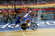 UK, August 6 2012: France's Gregory Bauge is pushed on to the track for the first ride of the Men's Sprint Final against Team GB's Jason Kenny on Day 10 of the London 2012 Olympic Games. Copyright 2012 Peter Horrell.
