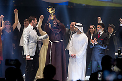 Kenyan Peter Tabichi (left) teacher at Keriko Secondary School in Nakuru, Kenya receives his « Global Teacher Prize 2019 » from Dubai's Crown Prince Shaikh Hamdan Bin Mohammad bin Rashid Al Maktoum (center) in Dubai, United Arab Emirates, on March 24, 2019. The Global Teacher Prize serves to underline the importance of educators and the fact that, throughout the world, their efforts deserve to be recognised and celebrated. The US $1 million award from the Varkey Foundation is presented annually to an exceptional teacher who has made an outstanding contribution to their profession. Photo by GESF-Balkis Press/ABACAPRESS.COM