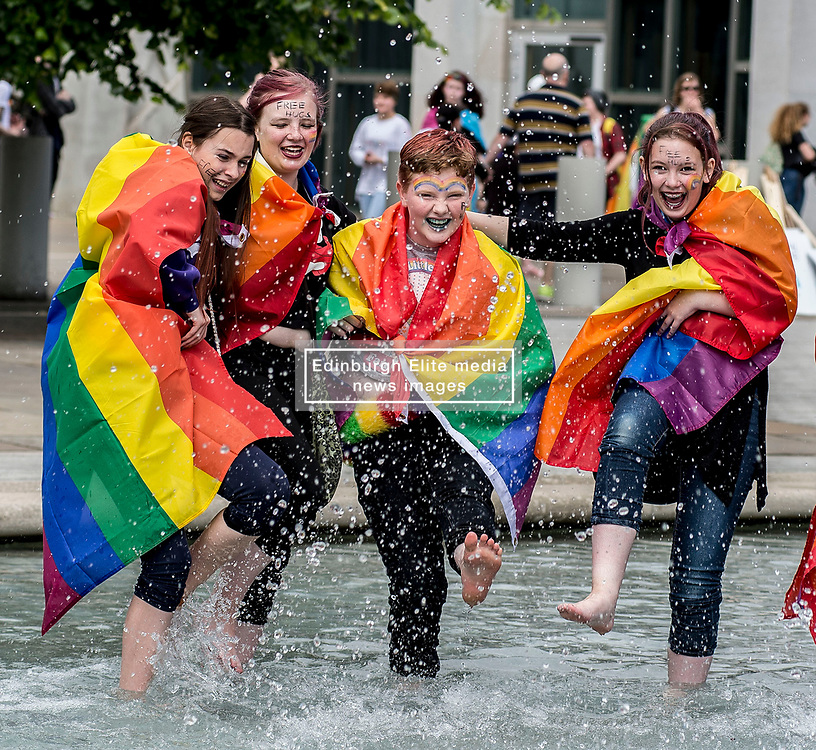 Friends Darren Carley, Mairi Spence, Ruby Smith and Macie Deas cool off before the annual Pride Edinburgh march took place from outside the Scottish Parliament.<br /> <br /> © Dave Johnston/ EEm