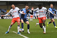 Wycombe Wanderers forward Anis Mehmeti (33)  battles for possession  with Luton Town midfielder Kai Naismith (24) and Luton Town midfielder Pelly-Ruddock Mpanzu (17) during the EFL Sky Bet Championship match between Wycombe Wanderers and Luton Town at Adams Park, High Wycombe, England on 10 April 2021.