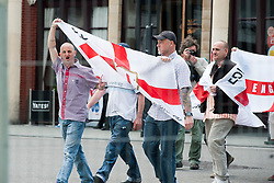 The English Defence League (EDL) return to Sheffield to lay flowers at Sheffield War Memorial which is fenced off to stop counter protesters occupying the whole of Barkers Pool<br /> <br /> 8 June 2013<br /> Image © Paul David Drabble<br /> www.pauldaviddrabble.co.uk