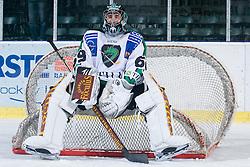 Matija Pintaric (HDD Tilia Olimpija, #69) sitting on the net during ice-hockey match between HDD Tilia Olimpija and EHC Liwest Black Wings Linz in 37th Round of EBEL league, on Januar 9, 2011 at Hala Tivoli, Ljubljana, Slovenia. (Photo By Matic Klansek Velej / Sportida.com)