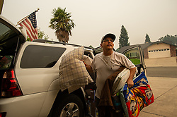 Resident Kenny Campbell returns home after his neighbor was given the clear sign during the Carr fire on Monday, July 30, 2018, in Redding, Calif. Photo by Paul Kitagaki Jr./Sacramento Bee/TNS/ABACAPRESS.COM