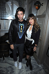 DAN WILLIAMS and JADE JAGGER at a party for Yves Saint Laurent's Creative Director Stefano Pilati given by Colin McDowell held at The Connaught Bar, The Connaught, Mount Street, London on 29th October 2008.