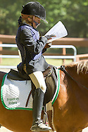 Middletown, New York - A young girl looks over a diagram of the course she will ride during the 70th annual Middletown Rotary Horse Show at Fancher-Davidge Park on Sept. 8, 2013.