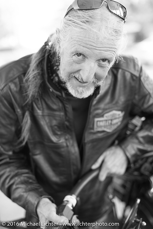Pat Simmons of the Doobie Brothers fills up at a gas stop during stage 16 (142 miles) of the Motorcycle Cannonball Cross-Country Endurance Run, which on this day ran from Yakima to Tacoma, WA, USA. Sunday, September 21, 2014.  Photography ©2014 Michael Lichter.