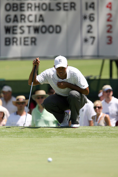 09 August 2007: Tiger Woods analyzes a putt for par on the 4th green during the first round of the 89th PGA Championship at Southern Hills Country Club in Tulsa, OK.