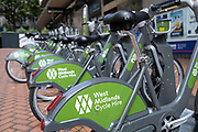 West Midlands Cycle Hire bicycles at a docking station in the city centre on 3rd August 2021 in Birmingham, United Kingdom. This cycle sharing scheme is available across the West Midlands, including Birmingham, Coventry, Sandwell, Stourbridge, Solihull, Sutton Coldfield, Walsall and Wolverhampton.