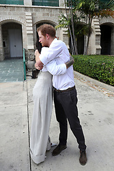 Prince Harry and Rihanna hug during the 'Man Aware' event held by the Barbados National HIV/AIDS Commission in Bridgetown, Barbados, during his tour of the Caribbean.