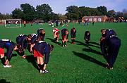 A3A7WA Boys' football team warming up before a match