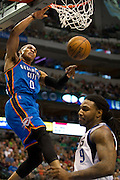 Russell Westbrook (0) of the Oklahoma City Thunder dunks the ball against the Dallas Mavericks at the American Airlines Center in Dallas on Sunday, March 17, 2013. (Cooper Neill/The Dallas Morning News)