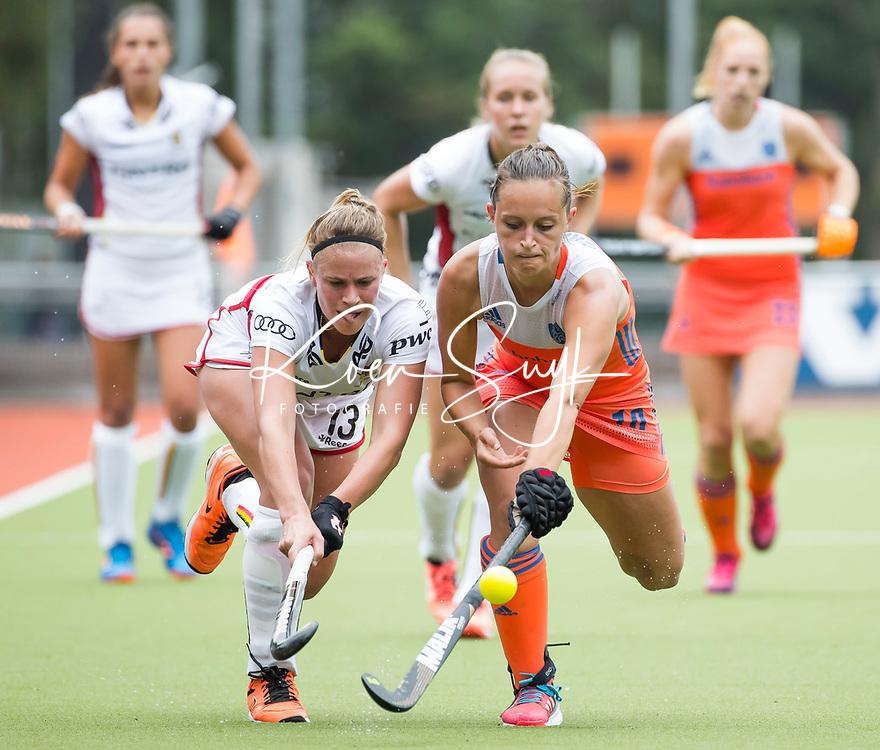 SCHIEDAM - Kelly Jonker met Alix GERNIERS (Bel)   tijdens een oefenwedstrijd tussen  de dames van Nederland en Belgie  (0-1), in aanloop naar het  EK Hockey, eind augustus in Amstelveen. ANP KOEN SUYK