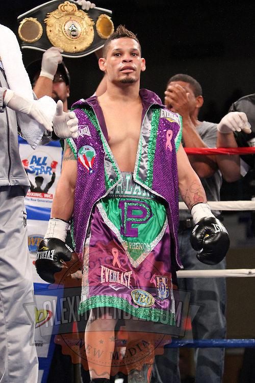 """Orlando Cruz, is introduced prior to a  fight against Jorge Pazos at the Kissimmee Civic Center in Kissimmee, Florida, on Friday, October 19, 2012. The Puerto Rican Cruz recently described himself as """"a proud gay man"""" and the first active boxer having pronounced so, in boxing history. (AP Photo/Alex Menendez)"""