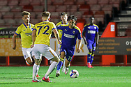 AFC Wimbledon midfielder Ethan Chislett (11) takes on Brighton and Hove Albion midfielder Ed Turns (72) during the EFL Trophy Southern Group G match between AFC Wimbledon and Brighton and Hove Albion U21 at The People's Pension Stadium, Crawley, England on 22 September 2020.