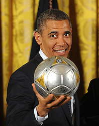 United States President Barack Obama holds a soccer ball as he welcome the Stanley Cup champion Los Angeles Kings and the Major League Soccer champion LA Galaxy to the White House to honor their 2012 championship seasons in a ceremony in the East Room of the White House in Washington, DC, USA, on march 26, 2013. Photo by Olivier Douliery/CNP/ABACAPRESS.COM  | 410053_010 Washinghton Etats-Unis United States