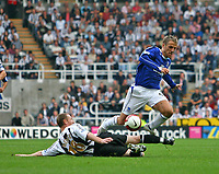 Photo: Andrew Unwin.<br /> Newcastle United v Everton. The Barclays Premiership. 24/09/2006.<br /> Everton's Phil Neville (R) tries to get over a tackle from Newcastle's Craig Moore (L).