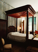 John Jr.'s Bedroom with canopy bed and swags of white lace wallpaper copied after wallpaper design in which room was decorated after his marraige, Melrose, Natchez National Historical Park, Mississippi.