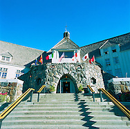 The main entrance to Timberline Lodge as seen in the summer months. Timberline Lodge is a mountain lodge on the south side of Mount Hood in Oregon, about 60 miles east of Portland. Built in the late 1930s as a Works Progress Administration project, this National Historic Landmark sits at an elevation of 5,960 feet, within the Mount Hood National Forest and is accessible through the Mount Hood Scenic Byway. It is a popular tourist attraction, drawing more than a million visitors annually. It is noted in film for serving as the exterior of the Overlook Hotel in The Shining.