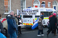Protesters march outside government buildings in Dublin Ireland as part of a campaign organised by the Irish Congress of Trade Unions