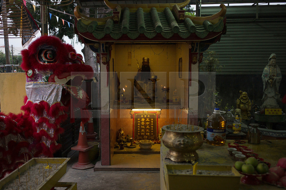 © Licensed to London News Pictures. 28/09/2014. Ipoh, Malaysia. Devotees in their lion costume pray at the Tong Tien Koon Temple as they prepare to process with deities through the street of central Ipoh, Malaysia on the 5th day of the Nine Emperor Gods Festival, Sunday, Sept. 28, 2014. The festival is a nine-day Taoist celebration to mark the birth of the Nine Emperor Gods from the first day to the ninth day of the ninth moon in Chinese Lunar Calender. The origin of the Nine Emperor Gods (stars of the Northern constellation) can be traced back to the Taoist worship of the Northern constellation during Qin and Han Dynasty and absorb this practice of worshipping the stars and began to deitify them as Gods. Photo credit : Sang Tan/LNP