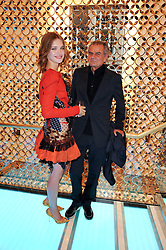 NATALIA VODIANOVA and PATRICK DEMARCHELIER at a party to celebrate the opening of the Louis Vuitton Bond Street Maison, New Bond Street, London on 25th May 2010.