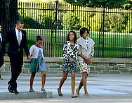 The First Family walks across LaFayette Park to St. John's Episcopal Church on September 19, 2010. (left to right, President Obama, Sasha Obama,Malia Obama, First Lady Michelle Obama) Photograph by Dennis Brack