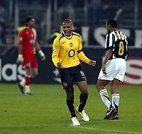 Photo: Chris Ratcliffe.<br /> Juventus v Arsenal. UEFA Champions League. Quarter-Finals. 05/04/2006. <br /> Thierry Henry celebrates with Emerson and Gianluigi Buffon in the background
