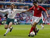 Photo: Leigh Quinnell.<br />England 'B' v Belarus. International Friendly. 25/05/2006.<br />England's Stewart Downing battles with Vladimir Korytko.