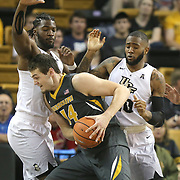 ORLANDO, FL - NOVEMBER 30: Reed Nikko #14 of the Missouri Tigers drives to the net against Chad Brown #21 and Dayon Griffin #10 of the UCF Knights during a NCAA basketball game at the CFE Arena on November 30, 2017 in Orlando, Florida. (Photo by Alex Menendez/Getty Images) *** Local Caption *** Reed Nikko; Chad Brown; Dayon Griffin