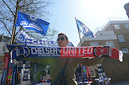 a Merchandiser sells half-and-half scarfs outside Stamford Bridge before k/o. Barclays Premier league match, Chelsea v Manchester Utd at Stamford Bridge Stadium in London on Saturday 18th April 2015.<br /> pic by John Patrick Fletcher, Andrew Orchard sports photography.