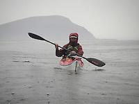 Kayaker in the rain - kajakkpadling i regnvær..