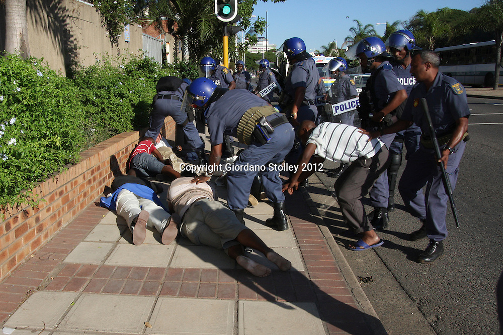 DURBAN - 18 May 2012 - Officers from the police's Public Order Policing Unit arrest protesting taxi drivers near the Durban Magistrates Court. The taxi drivers were demanding the release of their compatriots, who were arrested on Thursday during protests against the eThekwini Metro police..Picture: Giordano Stolley/Allied Picture Press/APP