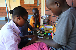 Sister Agie plays with children join with a special activity group at the MMS Angiya clinic during school holidays, where they will play games and be given a filling lunch. SAHFA baseline survey visit to the MMS Angiya Clinic., Homa Bay County, Kenya.  SAHFA Kenya © April 2019