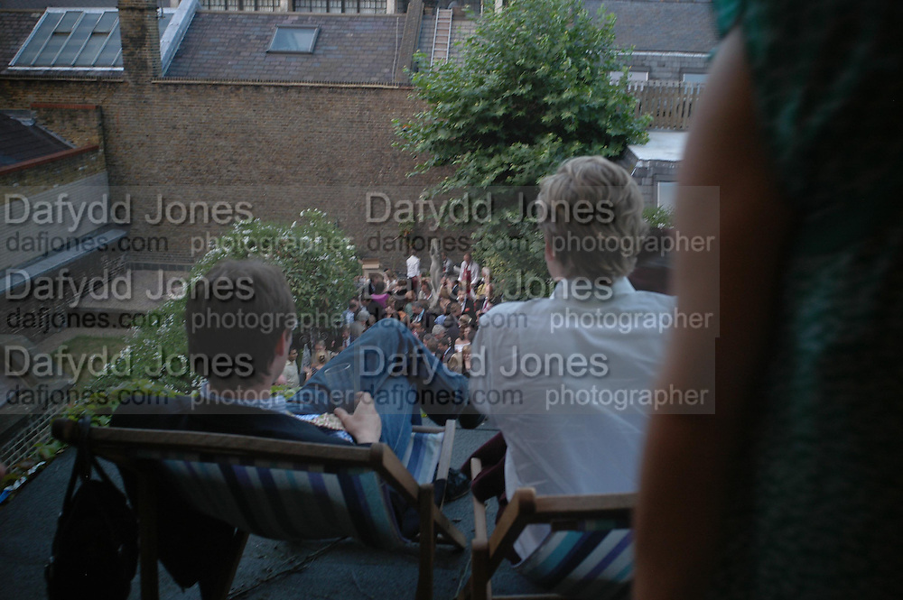 Spectator party. Doughty St. London. 28 July 2005. ONE TIME USE ONLY - DO NOT ARCHIVE  © Copyright Photograph by Dafydd Jones 66 Stockwell Park Rd. London SW9 0DA Tel 020 7733 0108 www.dafjones.com