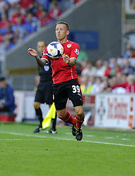 Cardiff City's Craig Bellamy controls the arial ball  - Photo mandatory by-line: Joe Meredith/JMP - Tel: Mobile: 07966 386802 25/08/2013 - SPORT - FOOTBALL - Cardiff City Stadium - Cardiff -  Cardiff City V Manchester City - Barclays Premier League