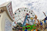 Brooklyn, New York, USA. 10th August 2013. Beyond the Tickets Booth to Deno's Wonder Wheel Park, is the iconic Wonder Wheel, at the 3rd Annual Coney Island History Day celebration. Taken with 180 degree fisheye lens.